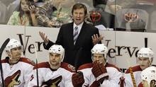 Phoenix Coyotes coach Wayne Gretzky's $8-million (U.S.) a year salary is often quoted as part of the team's mismanagement. (Ross D. Franklin)