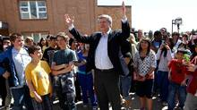 Conservative Leader Stephen Harper gestures while talking with children after casting his ballot at a polling station in a school in Calgary, Alberta May 2, 2011. (CHRIS WATTIE/REUTERS)