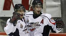 Windsor Spitfires' Eric Wellwood, left, celebrates his goal with teammate Adam Henrique during the first period of their Memorial Cup hockey tie-breaker game against the Rimouski Oceanics. (MATHIEU BELANGER)