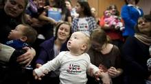 Heather Dodge and her 11-month-old daughter Leora(middle) along with other mothers and children attend an announcement by Midwives Association of British Columbia in Vancouver, Thursday, January 23, 2014. (Rafal Gerszak FOR THE globe and mail)