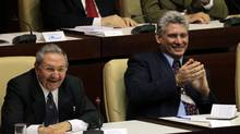 Cuban President Raul Castro, left, and newly elected first vice-president Miguel Diaz-Canel, attend the closing session of the National Assembly in Havana Feb. 24, 2013. (DESMOND BOYLAN/REUTERS)