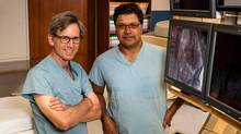 Dr. Stephen Fremes (left) and Dr. Sam Radhakrishnan are giving hope to previously-inoperable heart patients with the TAVI aortic-valve replacement procedure. (Doug Nicholson)