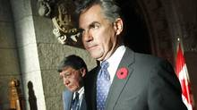 Environment Minister Jim Prentice leaves the foyer of the House of Commons after speaking to reporters on Nov. 2, 2010. (CHRIS WATTIE/REUTERS)