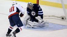 Washington Capitals' Martin Erat (10) scores the game winning shootout goal against Winnipeg Jets' goaltender Ondrej Pavelec (31) during NHL action in Winnipeg, Tuesday, October 22, 2013. (Trevor Hagan/THE CANADIAN PRESS)