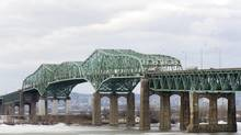 The Champlain Bridge spans the Saint Lawrence river in Montreal, Friday, March 18, 2011. The bridge is in need of major repair and has become a safety concern to motorists. (Graham Hughes/THE CANADIAN PRESS)
