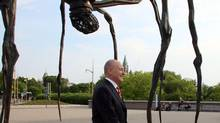 U.S. Ambassador to Canada Bruce Heyman walks by a sculpture of a giant spider as he makes his way to deliver a speech at the National Gallery of Canada in Ottawa, Monday June 2, 2014. (FRED CHARTRAND/THE CANADIAN PRESS)