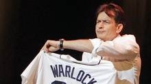 Charlie Sheen shows off his Detroit Tigers jersey during his performance at the Fox Theatre in Detroit. (Carlos Osorio / AP)