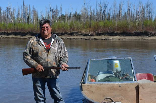 Athabasca Chipewyan First Nations member Marvin L'Hommecourt grew up on the Athabasca River but won't eat the fish there now. He works as a heavy equipment operated for Imperial Oil Ltd.'s Kearl oil sands project.