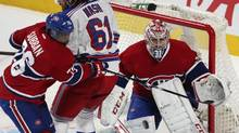 Montreal Canadiens goalie Carey Price (31) keeps his eyes on the puck as New York Rangers Rick Nash (61) and Canadiens P.K. Subban (76) battle for the rebound during the first period of their NHL action in Montreal, March 30, 2013. ) (CHRISTINNE MUSCHI/REUTERS)