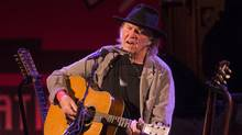 Neil Young performs in Toronto on Jan. 12, 2014. (CHRIS YOUNG FOR THE GLOBE AND MAIL)