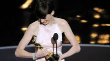 Anne Hathaway accepts the award for best actress in a supporting role for 'Les Miserables' during the Oscars at the Dolby Theatre on Sunday Feb. 24, 2013, in Los Angeles. (Chris Pizzello/AP)