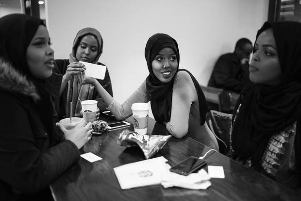 Leyla Qurey, Deeqo Qurey, Fadumo Hussein and Susu Hussein gather at a local Starbucks.