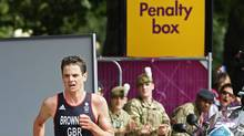 Great Britain's Jonathan Brownlee runs out the penalty box during the men's triathlon at the 2012 Summer Olympics, Tuesday, Aug. 7, 2012, in London. (Associated Press)