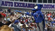 Ace, the Toronto Blue Jays mascot, tosses a seat cushion to fans between innings in a spring training exhibition baseball game against the Philadelphia Phillies in Dunedin, Fla., Monday, March 25, 2013. (KATHY WILLENS/AP)
