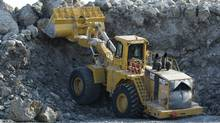 A caterpillar 992G loader removes rocks and tundra at The Meadowbank Gold Mine located in the Nunavut Territory of Canada on Tuesday, March 24, 2009. (NATHAN DENETTE/The Canadian Press)