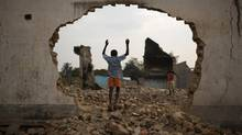 A boy plays at the site of a demolished Muslim religious centre next to a mosque in the capital Bangui Feb. 8. (SIEGFRIED MODOLA/REUTERS)