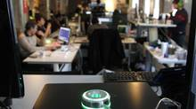 A CanFocus device on a desk in the Toronto office of Bnotions. The person managing the device turns the light to red if he doesn't want to be disturbed at his work. (Fernando Morales/The Globe and Mail)