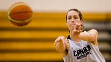 Canadian women's national basketball team centre Krysten Boogaard, sister of late NHL player Derek Boogaard, passes during practice at the University of the Fraser Valley in Abbotsford, B.C., on Wednesday May 16, 2012. (DARRYL DYCK FOR THE GLOBE AND MAIL)