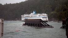The ferry Queen of Nanaimo sits in shallow water on Saturday Nov. 2, 2013 at Village Bay, B.C. after high winds knocked the vessel out of position at it was departing the terminal. The accident has suspended all service to the Gulf Island until further notice. (Sue Kendall/THE CANADIAN PRESS)