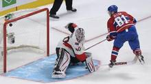 Montreal Canadiens' Lars Eller scores against Ottawa Senators goaltender Robin Lehner during shootout NHL action in Montreal, Wednesday, March 13, 2013. (Graham Hughes/THE CANADIAN PRESS)