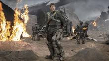 In Doug Liman's Edge of Tomorrow, Tom Cruise plays a cowardly soldier turned hero as he fights the same battle over and over again. (David James)