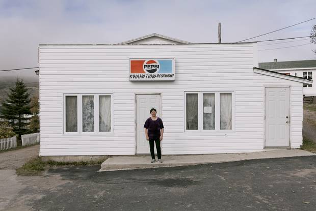 This photo of owner Huang Feng Shu posing in front of Kwang Tung Restaurant in Fogo Island, Nfld., inspired the writer's journey.
