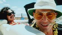 "Johnny Depp (right) as Hunter S. Thompson and Benicio Del Toro (left) as his lawyer ""Dr. Gonzo"" star in Fear and Loathing in Las Vegas. CP/handout (CP)"