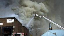 Firefighters battle a six-alarm fire near Dufferin Street and Eglinton Avenue in Toronto March 27, 2014. (Kevin Van Paassen/The Globe and Mail)