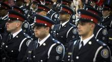 Toronto, Ontario - May 14, 2014 -- TORONTO POLICE GRADUATION-- Recruit class 14-01 stand during the Toronto Police College Graduation Ceremony in Toronto, Wednesday May 14, 2014 The police services board sent a blunt message to the chief in April, making it clear it was not happy with his efforts to find efficiencies in the force. (Mark Blinch for the Globe and Mail) (Mark Blinch For The Globe and Mail)