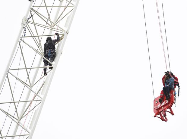 A woman is rescued from a downtown Toronto crane early on April 26, 2017.