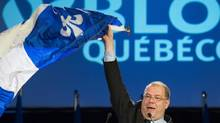 Mario Beaulieu waves a Quebec flag during his speech in Montreal on Saturday after being named new Leader of the Bloc Québécois. (Graham Hughes/THE CANADIAN PRESS)