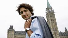 Liberal MP Justin Trudeau makes his way across the front lawn of Parliament Hill on June 19, 2012. (Sean Kilpatrick/The Canadian Press)