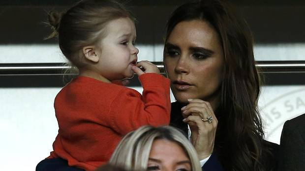 Former Spice Girls singer Victoria Beckham carries daughter Harper as she arrives for the French Ligue 1 soccer match of her husband David Beckham with his Paris Saint-Germain team against Brest at the Parc des Princes stadium in Paris May 18, 2013. (GONZALO FUENTES/REUTERS)