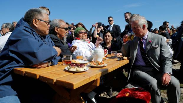 Britain's Prince Charles drinks tea during a tour of Sylvia Grinnell Park in Iqaluit, Nunavut, Canada, June 29, 2017.