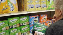 A shopper looking at Swiffer roducts. (NATI HARNIK/AP)