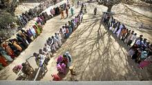 Indian voters stand in a queue to cast their votes at a polling station near Moradabad 158 kilometers from New Delhi, India, March 3, 2012. (Manish Swarup/AP/Manish Swarup/AP)