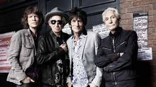 The Rolling Stones' Mick Jagger, Keith Richards, Ronnie Wood and Charlie Watts in front of The Marquee Club in London in July 2012. (Reuters)
