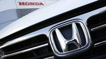 A Honda Odyssey car is displayed outside Honda Motor Co's showroom in Tokyo Jan. 31, 2013. Honda Motor Co. Ltd. trimmed its annual net profit forecast by 1.3 per cent after car sales have been knocked in China, and as it continues to struggle in Europe. (ISSEI KATO/REUTERS)