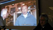 Lawyer Gordon Oldham, right, shows his video of the conversation with Hong Kong casino tycoon Stanley Ho (Kin Cheung/AP)