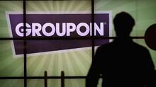 CHICAGO, IL - JUNE 10: The Groupon logo is displayed in the lobby of the company's international headquarters on June 10, 2011 in Chicago, Illinois. Groupon, a local e-commerce marketplace that connects merchants and consumers by offering goods and services at a discount, announced June 2 that it had filed with the Securities and Exchange Commission for a proposed initial public offering of its Class A common stock. The company, launched in Chicago in November 2008 now markets products and services in 43 countries around the world. (Photo by Scott Olson/Getty Images) (Scott Olson/2011 Getty Images)