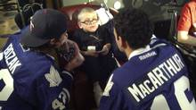 Tyler Bozak and Clarke MacArthur chat with Zane Braun at SickKids in Toronto on Tuesday, February 12, 2012. (James Mirtle/The Globe and Mail)