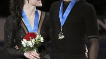 Tessa Virtue and Scott Moir react after winning the senior ice dance competition at the Canadian National Figure Skating Championships in Mississauga on Sunday. (FRED THORNHILL/REUTERS)