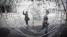 A damaged store front window along Robson Street in Vancouver June 23, 2011. (John Lehmann/The Globe and Mail/John Lehmann/The Globe and Mail)