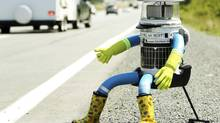 Hitchbot sits on the shoulder of Highway 102 to begin its 6,000-kilometre cross-country journey outside of Halifax on July 27, 2014. (PAUL DARROW/REUTERS)