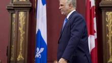 Philippe Couillard walks to his seat following his speech at the swearing in ceremony, Thursday, April 17, 2014 at the legislature in Quebec City. (Jacques Boissinot/THE CANADIAN PRESS)