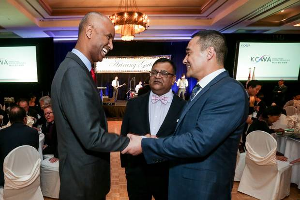Mr. Hussen shakes hands with John Jung Ko, president of the Korean Canadian Business Association, at the Korean Canadian Women's Association Family & Community Services Arirang Gala in Toronto's Richmond Hill neighbourhood on Feb. 25.