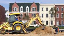 Workers prepare a new housing lot at a construction site in Alexandria, Va. (KEVIN LAMARQUE/REUTERS)