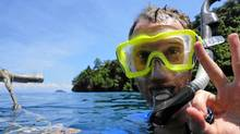 Robin Esrock signals it's all good on his first scuba dive in Papua New Guinea (Christina Koukkos for the Globe and Mail/Christina Koukkos for the Globe and Mail)