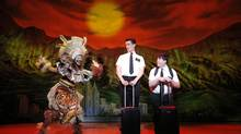 Phyre Hawkins, Mark Evans, Christopher John O'Neill in The Book of Mormon. (Joan Marcus)