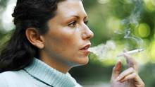 portrait of a young woman smoking a cigarette (Stockbyte/Getty Images)